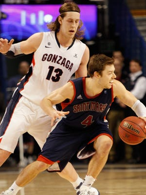 Saint Mary's guard Matthew Dellavedova looks to drive past Gonzaga's Kelly Olynyk during a Jan. 10 game earlier this season in Spokane, Washington.