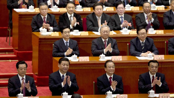 China's top leaders, from left in front row, Chinese President Hu Jintao, Communist Party chief Xi Jinping, Chinese Premier Wen Jiabao and Li Keqiang, a member of the Politburo standing committee, applaud during the opening session of the Chinese People's Political Consultative Conference in Beijing on March 3.