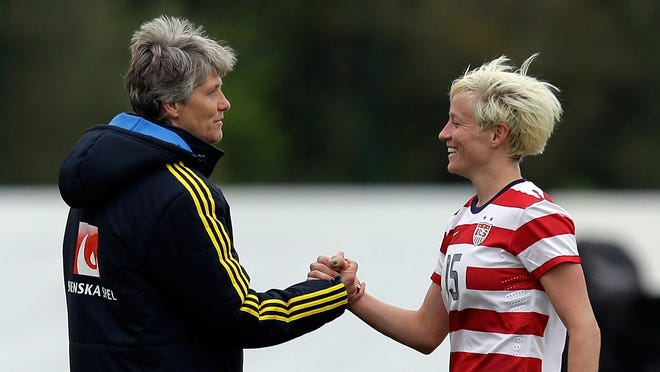 Megan Rapinoe (right) of the U.S., shakes hands with Sweden's head coach Pia Sundhage at the end of their Algarve Cup  women's soccer match Monday in Lagos, southern Portugal. The game ended in a 1-1 draw.