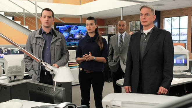 Cote de Pablo, second from left, will be leaving an 'NCIS' cast that includes, from left, Sean Murray, Rocky Carroll and Mark Harmon.