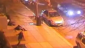 Surveillance video released on YouTube by Washington, D.C., police shows two cars opening fire in a drive-by shooting as crowds on the sidewalk run or fall to the pavement. One person was shot in the back, but most were in the legs and arms.