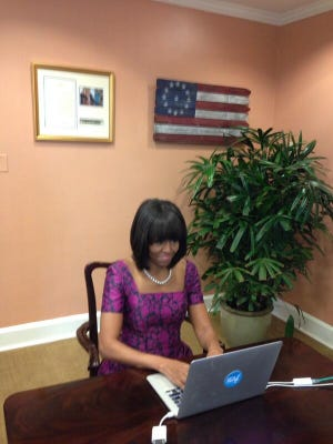 First lady Michelle Obama answers questions via Twitter during session in her White House office.