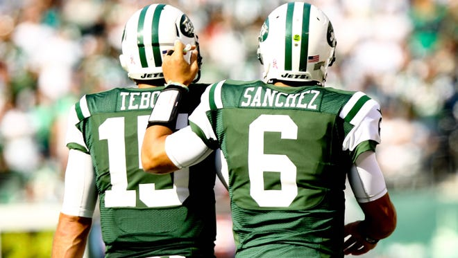 New York Jets quarterback Mark Sanchez (6) congratulates quarterback Tim Tebow (15) after a play last season against the Indianapolis Colts
