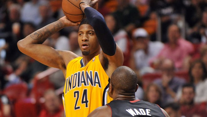 Indiana Pacers small forward Paul George (24) is defended by Miami Heat shooting guard Dwyane Wade (3) in Sunday's game.