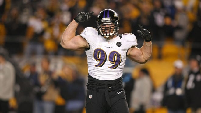 Baltimore Ravens linebacker Paul Kruger (99) celebrates as time expires against the Pittsburgh Steelers at Heinz Field.