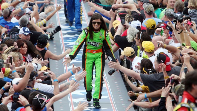 Danica Patrick greets fans as she is introduced before the 2013 Daytona 500 at Daytona International Speedway.
