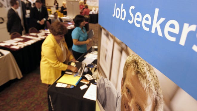 People attend a jobs fair in Green Tree, Pa.