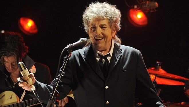 In this 2012 file photo, Bob Dylan performs during the 17th annual Critics' Choice Awards in Los Angeles. The century-old American Academy of Arts and Letters says Dylan has become the first rock star to join the ranks of its artists, who include Philip Roth and Jasper Johns.