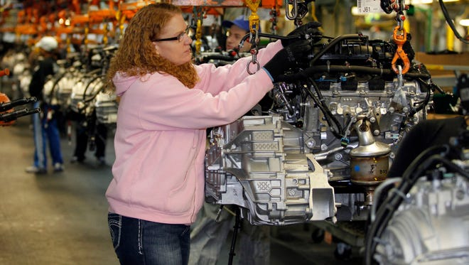 Tina Knudson works in engine assembly at the General Motors Fairfax Assembly and Stamping Plant in Kansas City, Kan.