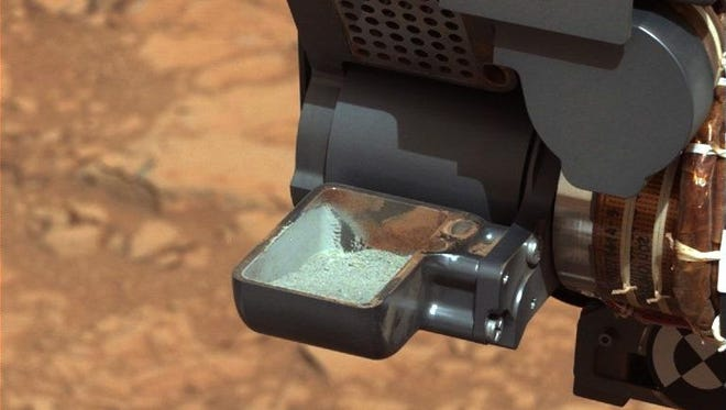 A view of the gray interior rock sample drilled on Mars and analyzed by the Curiosity rover.