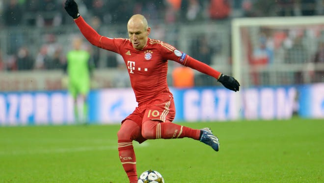 Bayern's Arjen Robben of the Netherlands controls a ball during the Champions League round of 16 match between FC Bayern Munich and FC Arsenal. Bayern advanced to the quarterfinals despite losing to Arsenal, 2-0.