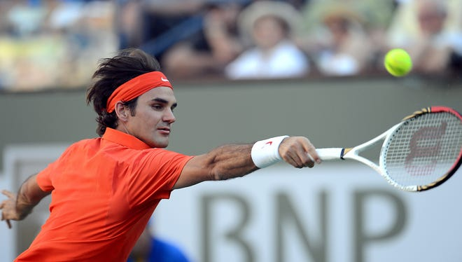 Roger Federer hits a backhand during his match against Stanislas Wawrinka at the BNP Paribas Open at the Indian Wells Tennis Garden. Federer won in three sets.