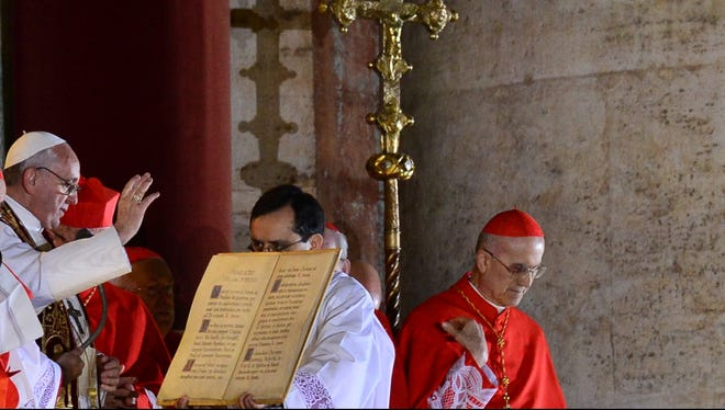 Pope Francis gives the benediction at St. Peter'sw basilica after being elected pope.