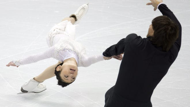 Yuko Kavaguti and Alexander Smirnov, of Russia, perform in the pairs short program at the World Figure Skating Championships in London, Ontatio, on Wednesday.