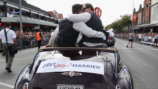 A float supporting gay marriage moves down Ponsonby Road during the Pride parade in February in Auckland, New Zealand.