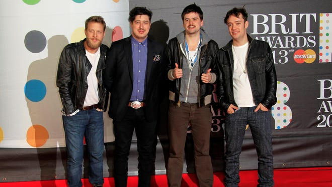 Ted Dwane, left, Marcus Mumford, Country Winston and Ben Lovett of British band Mumford and Sons at the BRIT Awards 2013 in London.