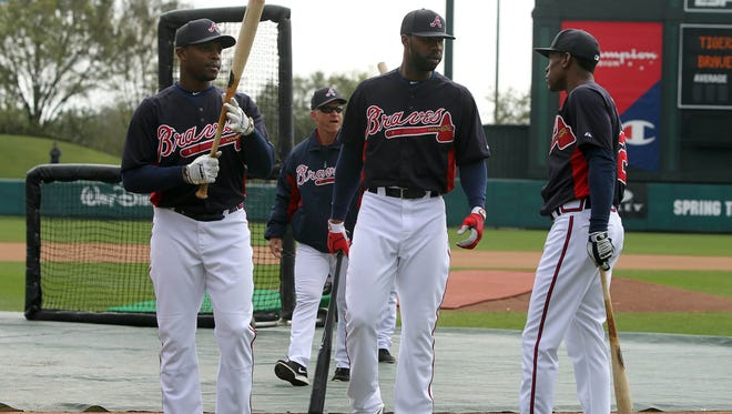 The Atlanta Braves will rely on outfielders (from left) Justin Upton, Jason Heyward and B.J. Upton to provide a sizable chunk of their run production this season.