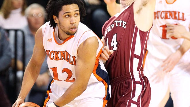 Bucknell Bison guard Bryson Johnson dribbles the ball as Lafayette Leopards guard Bryce Scott (blocks in the first half during the championship game of the Patriot League tournament at the Sojka Pavilion.