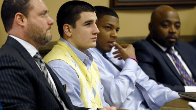 From left, defense attorney Adam Nemann,  defendant Trent Mays, 17, defendant 16-year-old Ma'lik Richmond and Richmond's attorney, Walter Madison, listen to testimony during Mays' and Richmond's rape trial Thursday in juvenile court in Steubenville, Ohio.