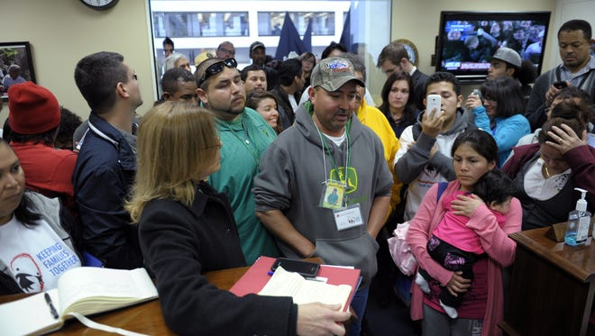 Protesters supporting immigration reform gather inside the office of Sen. Mark Rubio, R-Fla., following a national bus tour culminating on Capitol Hill on Wednesday.