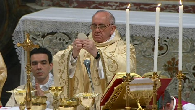 Pope Francis celebrates his inaugural Mass with cardinals inside the Sistine Chapel at the Vatican on Thursday.