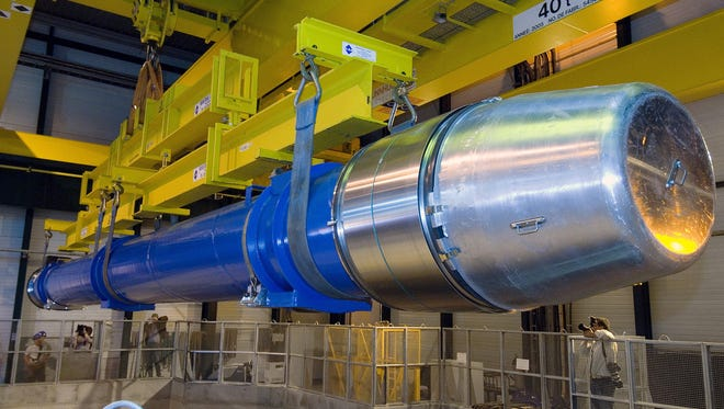 CERN's atom smasher, the $10 billion Large Hadron Collider that lies beneath the Swiss-French border, has been creating high-energy collisions of protons to investigate how the universe came to be the way it is.