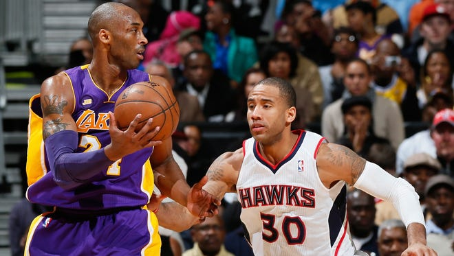 The foul that wasn't called on Dahntay Jones (30) of the Atlanta Hawks against Kobe Bryant (24) of the Los Angeles Lakers has put the Lakers in an interesting position if Bryant is hurt.