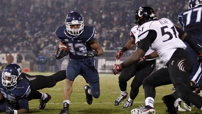 Until it finds a stronger passing game, Connecticut will continue to lean heavily on running back Lyle McCombs.