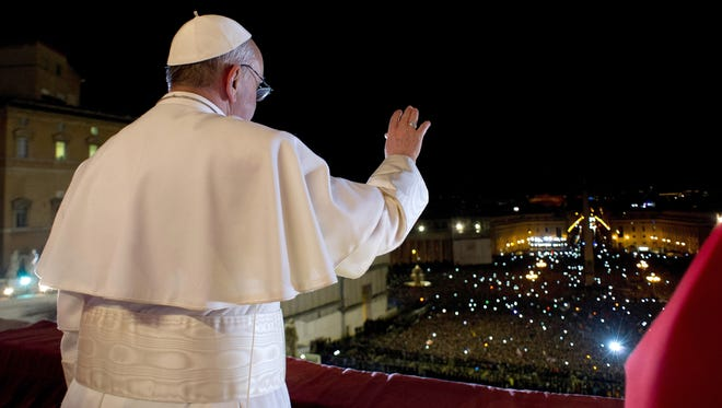 Newly elected Pope Francis appears on the central balcony of St Peter's Basilica on Wednesday in Vatican City.