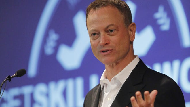 "Actor Gary Sinise, known for his roll as Lt. Dan in the movie ""Forest Gump,"" helps to honor veterans who completed the inaugural class of the ""Get Skills to Work"" program, which trains veterans for careers in manufacturing."