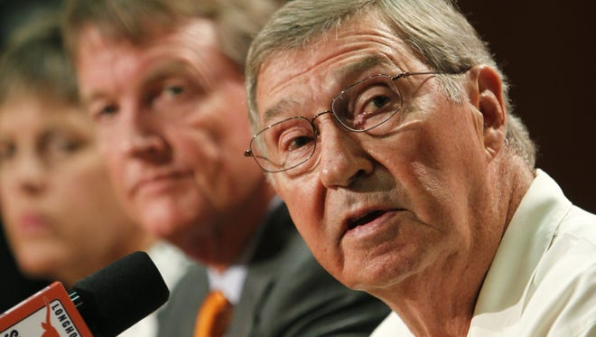 University of Texas at Austin Men's Athletics Director DeLoss Dodds, right, says he has no interest in a paying athletes in certain men's sports to the detriment of other teams at the university.