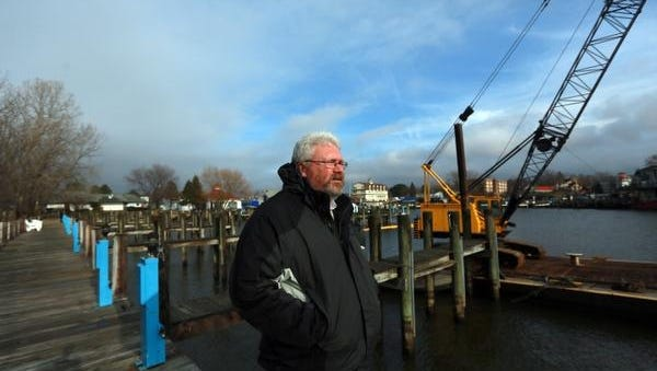 A crane used to dredge the Museum Marina sits in the marina Jan. 11 in South Haven, Mich. Dredging keeps boats from hitting the bottom of the marina and keeps commerce going, says harbormaster Paul VandenBosch.