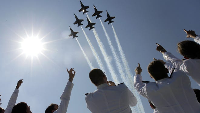 Blue Angel fighter jets perform a flyover above graduating Midshipmen during the U.S. Naval Academy graduation ceremony last May.