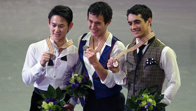 From left to right, Denis Ten of Kazakhstan, Patrick Chan of Canada and  Javier Fernandez of Spain pose with their medals  at the World Figure Skating Championships in London, Ontario, on Saturday.