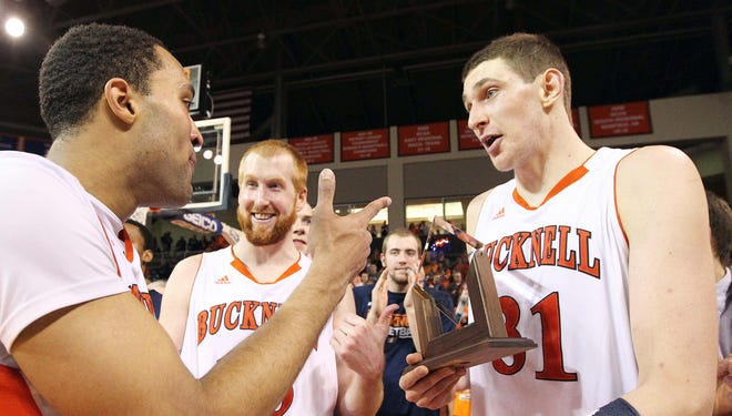 Bucknell center Mike Muscala, right, talks with his teammates after defeating the Lafayette Leopards 64-56 in the championship game of the Patriot League tournament.