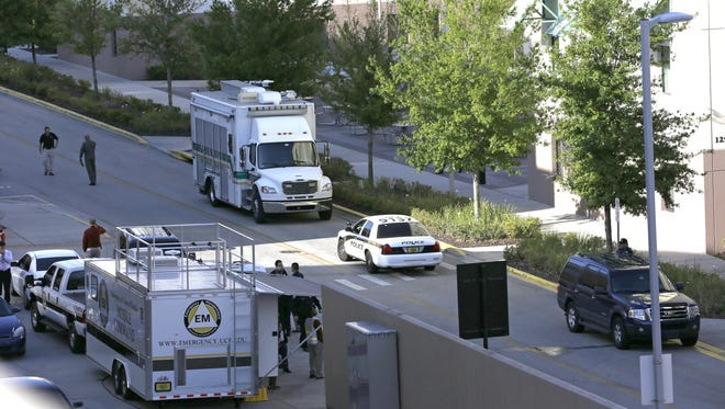 Police monitor the campus at the University of Central Florida after explosive devices were found by authorities investigating the apparent suicide of a student in a dorm.