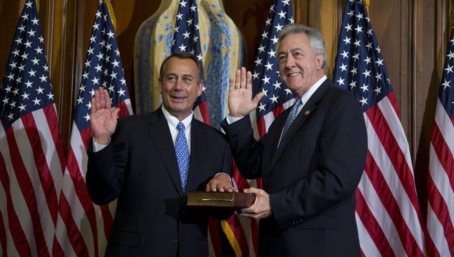 House Speaker John Boehner of Ohio performs a mock swearing-in for Rep. Rodney Alexander, R-La., on Jan. 3.