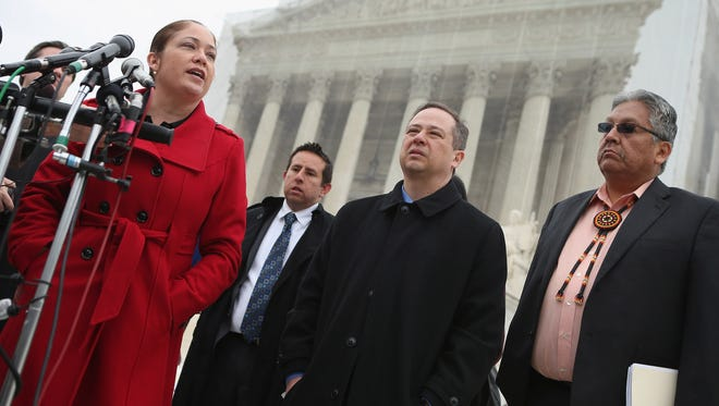 From left, Nina Perales and Luis Figaroa of the Mexican American Legal Defense and Education Fund, Jon Greenbaum, chief counsel for the Lawyers' Committee for Civil Rights Under Law, and San Carlos Apache Tribal Chairman Terry Rambler speak with reporters after attending oral arguments in the Arizona voter registration case before the Supreme Court on Monday.