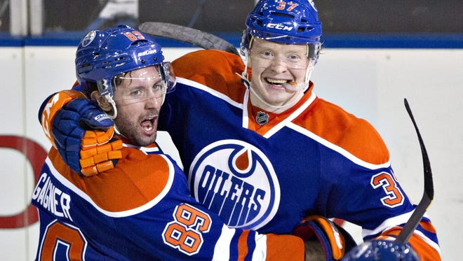 Edmonton's Sam Gagner (89) and Lennart Petrell (37) celebrate Petrell's goal against the Nashville Predators during the third period.