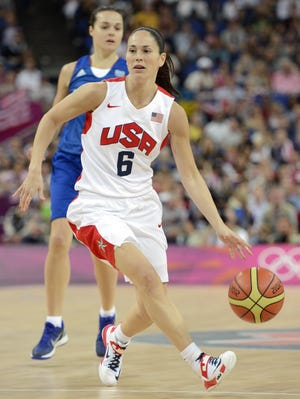 Sue Bird dribbles up the court for Team USA during the victorious gold medal against France at the 2012 Beijing Olympics.