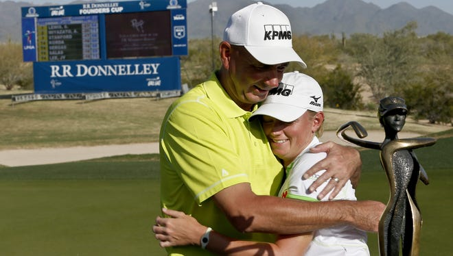 Stacy Lewis gets a hug from the guy who she would always pick for her dream foursome, which only needs to be a twosome, her father, Dale Lewis.