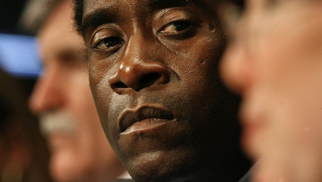 Don Cheadle, actor and activist, listens to fellow witnesses while testifying before the US Senate Judiciary Committee's Human Rights and the Law Subcommittee February 5, 2007 in Washington, DC.