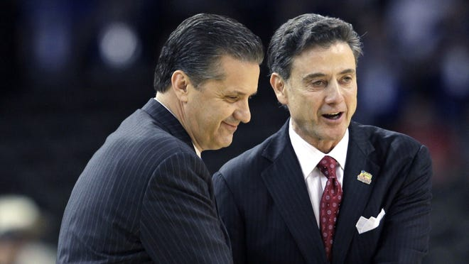 Louisville head coach Rick Pitino, right, with Kentucky head coach John Calipari during the Final Four game in New Orleans last March.