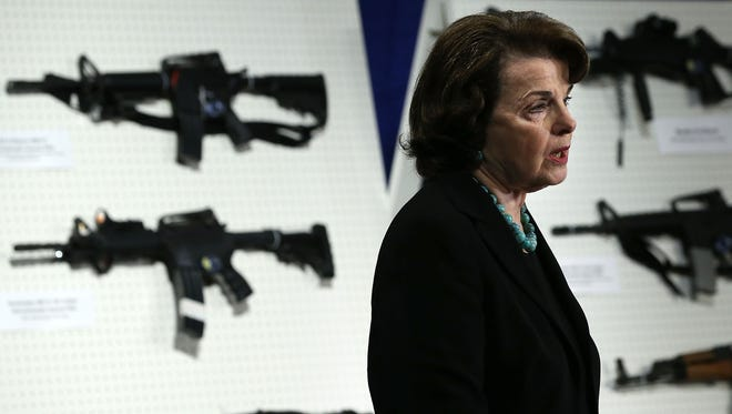 Sen. Dianne Feinstein, D- Calif., speaks next to a display of assault weapons during a news conference Jan. 24.