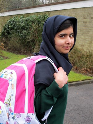 Pakistani schoolgirl Malala Yousafzai in Birmingham, England, on Tuesday on her way to school for the first time since a Taliban gunman shot her in the head in October in Pakistan because she advocated education for girls