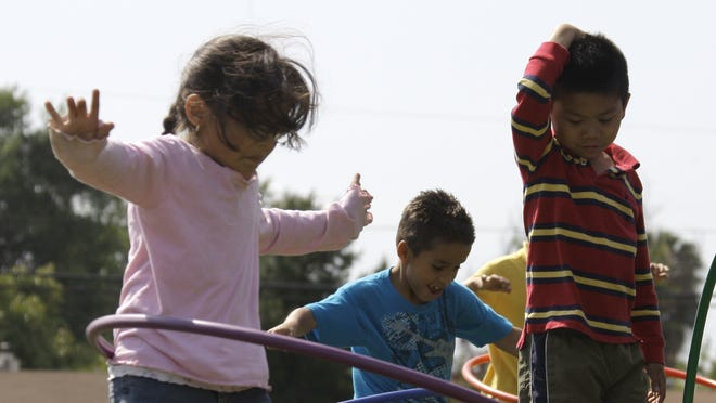 Children at Tracy Elementary School in Baldwin Park, Calif., spin hula-hoops in this 2011 photo.