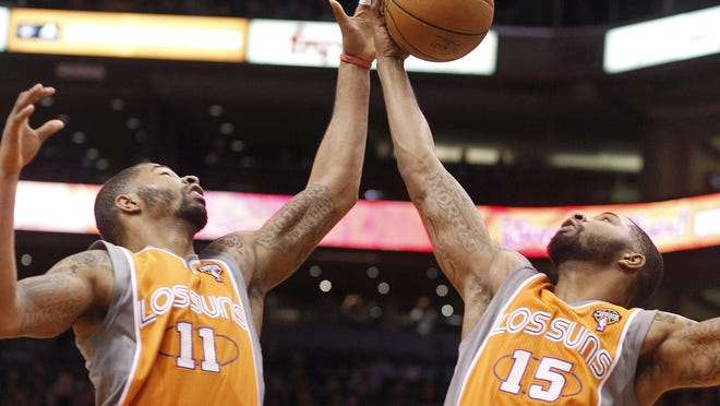 Phoenix Suns forwards, and twin brothers, Markieff Morris, left, and Marcus Morris, right, are in sync with everything.