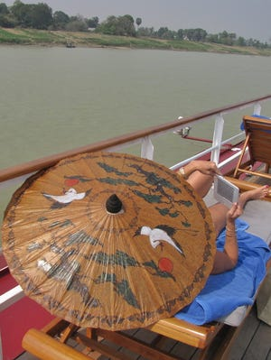 Beating the Burmese heat on board the Road to Mandalay, which includes a small swimming pool.