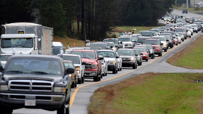 Traffic is backed up about one mile on Ala. 79  due to traffic lights malfunctioning March 18, 2013.
