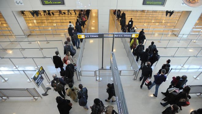 Travelers enter the U.S. Customs facility at Dulles International Airport.